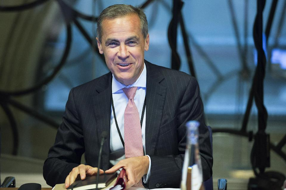 Mark Carney, the new Governor of the Bank of England, attends a monetary policy committee (MPC) briefing on his first day on the job inside the central bank's headquarters in London Monday July 1, 2013. (AP Photo/Jason Alden/Pool)