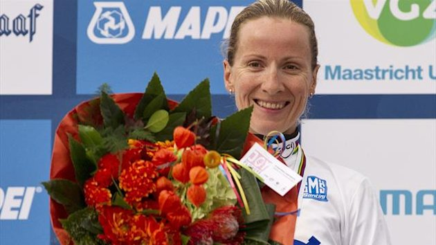 Judith Arndt of Germany celebrates on the podium after winning the women&#39;s elite time trial at the UCI Road World Championships