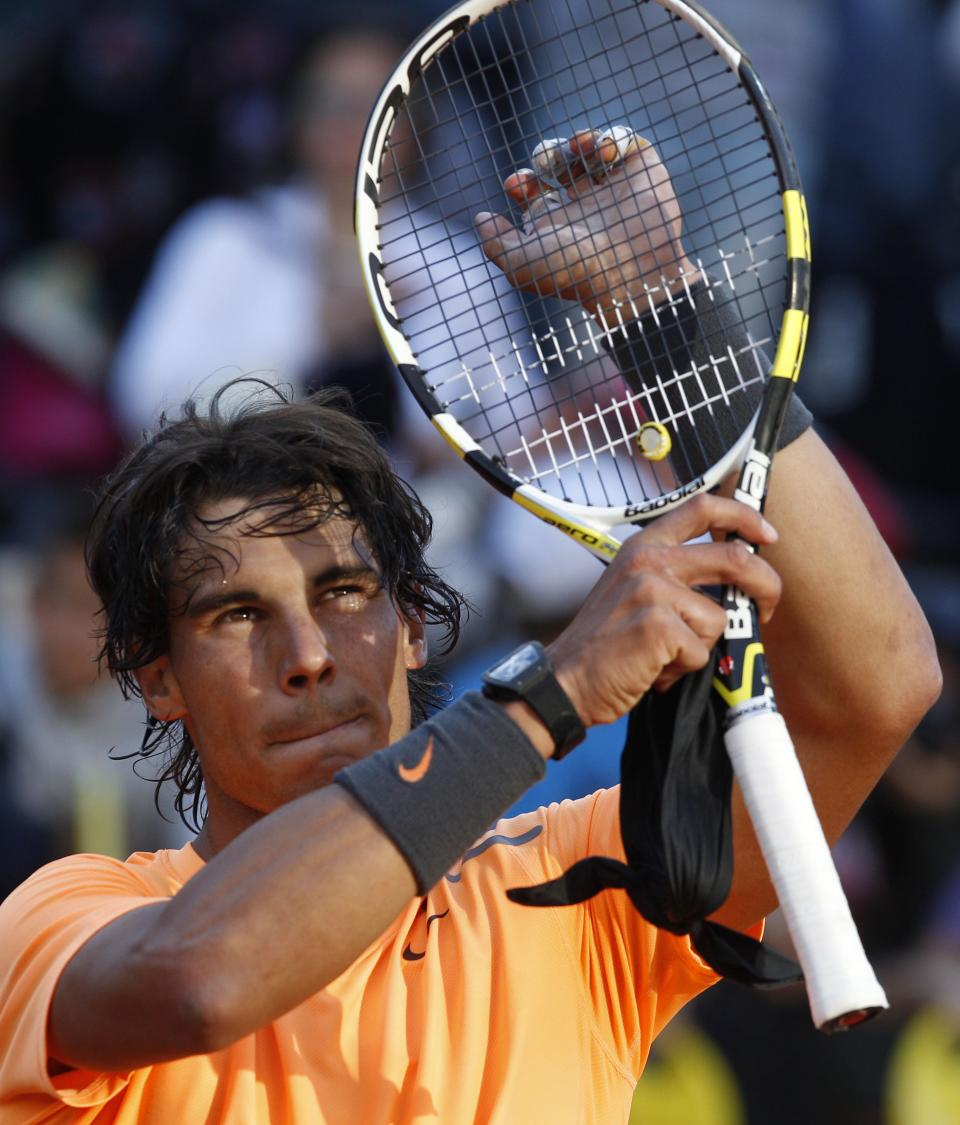Spain's Rafael Nadal celebrates after beating Spain's Marcel Granollers at the end of their match at the Italian Open tennis tournament, in Rome, Thursday,  May 17, 2012. Nadal won 6-1, 6-1.  (AP Photo/Alessandra Tarantino)