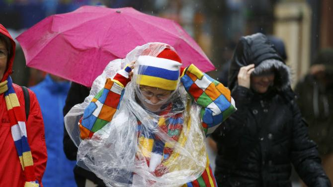 Carnival reveller battles the wind and rain after Rosenmontag parade cancelled in Mainz