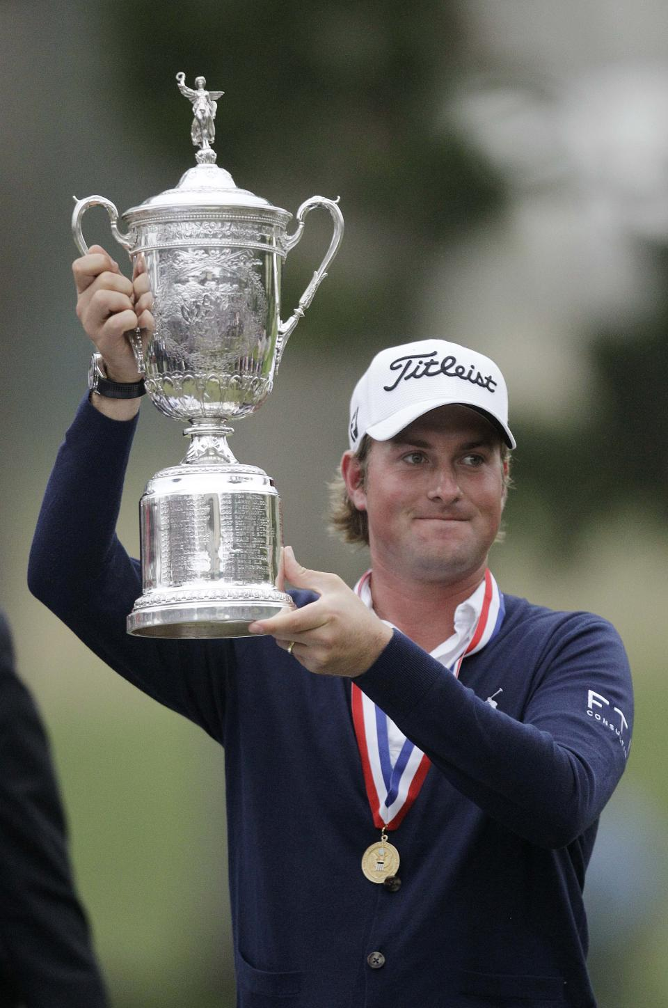 Webb Simpson holds up the championship trophy after the U.S. Open Championship golf tournament Sunday, June 17, 2012, at The Olympic Club in San Francisco. (AP Photo/Ben Margot)