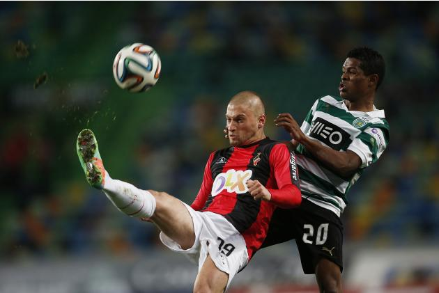 Sporting's Heldon fights for the ball with Olhanense's Dionisi during their Portuguese premier league soccer match at Alvalade stadium in Lisbon