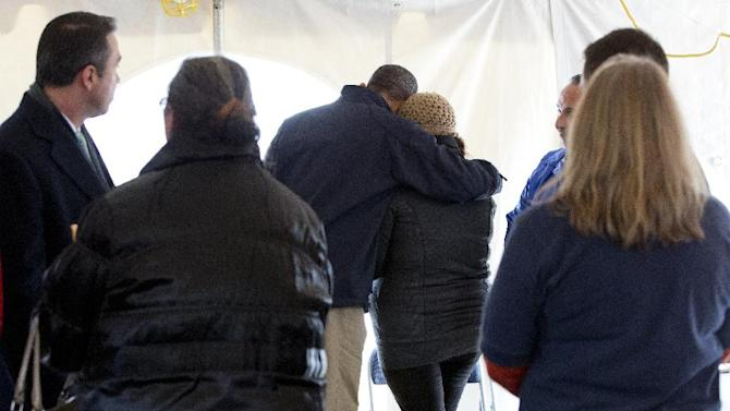 President Barack Obama comforts a woman at the FEMA recovery center on the grounds of New Dorp High School, Thursday, Nov. 15, 2012, on Staten Island, in New York. (AP Photo/Carolyn Kaster)
