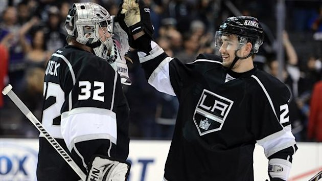 Jonathan Quick #32 of the Los Angeles Kings and Slava Voynov #26 celebrate a 5-2 win over the Anaheim Ducks at Staples Center on February 25, 2013 in Los Angeles, California