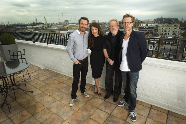 Actors Michael Fassbender, left, Noomi Rapace, and Guy Pearce, right, pose for photographs with Director Sir Ridley Scott, at a central London hotel following an interview with the Associated Press for the World Premiere of Prometheus, Saturday, June 2, 2012. (AP Photo/Joel Ryan)