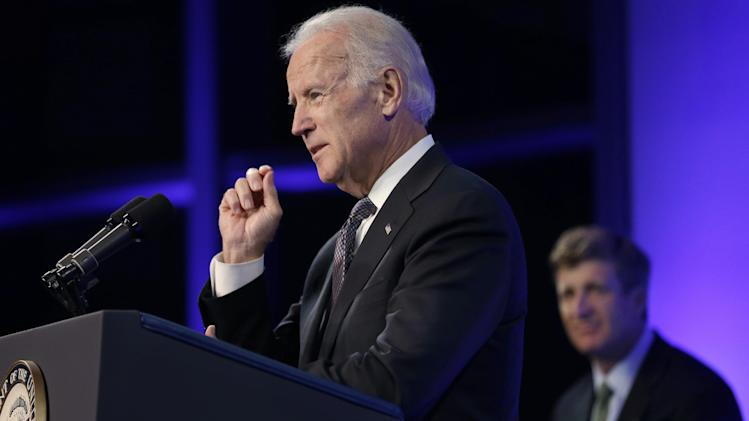 Vice President Joe Biden, left, addresses an audience during a forum on mental health policies that marks the 50th anniversary of President John F. Kennedy's signing of the Community Mental Health Act, Wednesday, Oct. 23, 2013, at the JFK Library and Museum in Boston. Former Rhode Island Congressman Patrick Kennedy looks on at right. (AP Photo/Steven Senne)