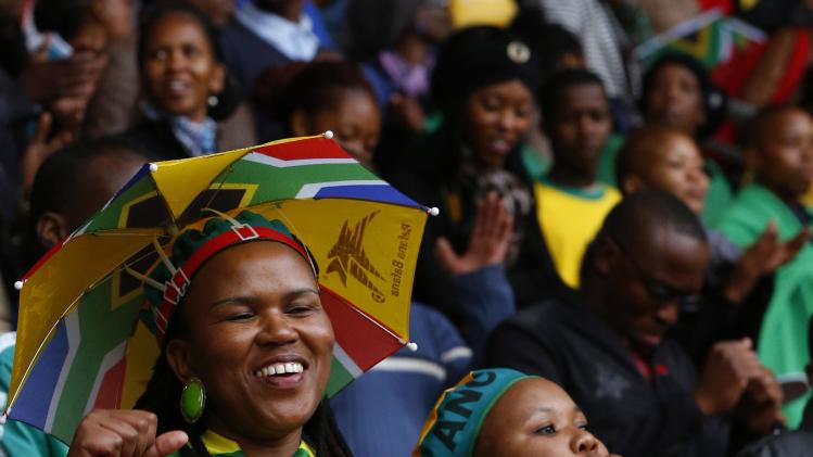 People sing and dance at FNB Stadium ahead of Mandela's national memorial service in Johannesburg