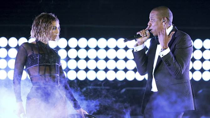"FILE - This Jan. 26, 2014 file photo shows Beyonce, left, and Jay Z performing ""Drunk in Love"" at the 56th annual Grammy Awards in Los Angeles. The couple performed Saturday night, July 6, 2014, at Citizens Bank Park in Philadelphia, as part of their On the Run tour (Photo by Matt Sayles/Invision/AP, File)"