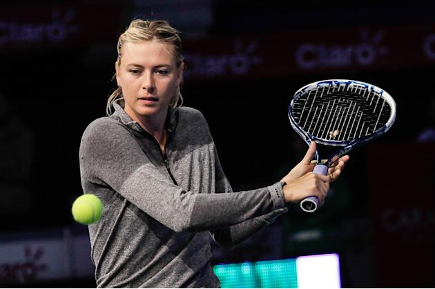 BOGOTA, Dec. 7, 2013 (Xinhua/IANS) -- Tennis player Maria Sharapova of Russia participates in a tennis practice with children and young people of various tennis academies in Bogota city, Colombia, on