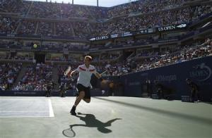 Murray of Britain chases down a return to Wawrinka of Switzerland at the U.S. Open tennis championships in New York