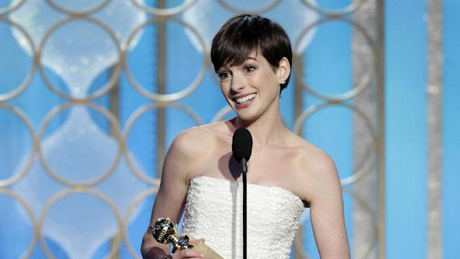 """This image released by NBC shows Anne Hathaway with her award for best supporting actress in a motion picture for her role in """"Les Miserables"""" during the 70th Annual Golden Globe Awards at the Beverly Hilton Hotel on Jan. 13, 2013, in Beverly Hills, Calif. (AP Photo/NBC, Paul Drinkwater)"""