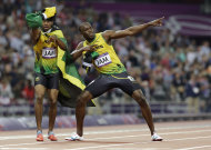 Jamaica's Usain Bolt, right, and Yohan Blake celebrate their win in the men's 4 x 100-meter relay during the athletics in the Olympic Stadium at the 2012 Summer Olympics, London, Saturday, Aug. 11, 2012. Jamaica set a new world record with a time of 36.84 seconds. (AP Photo/Anja Niedringhaus)