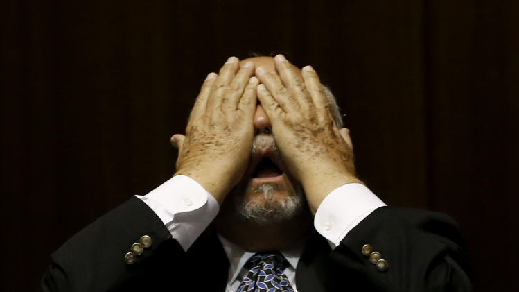 Rep. Macario Saldate, D-Tucson, rubs his eyes during a special session budget battle for Medicaid funding on Wednesday, June 12, 2013, in Phoenix.  The Arizona Legislature is on track to pull an all-nighter and work into Thursday to finish a state budget and approve Medicaid expansion. (AP Photo/Ross D. Franklin)