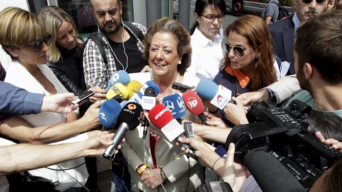 Valencia's Mayor Rita Barbera talks to the media after casting her ballot during Spanish regional and local elections in Valencia