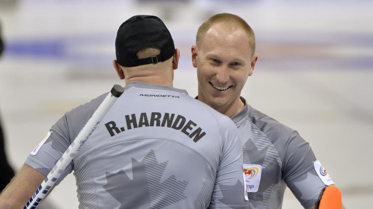 Skip Jacobs celebrates his victory against Team Martin with lead Harnden during the Roar of the Rings Canadian Olympic Curling Trials in Winnipeg