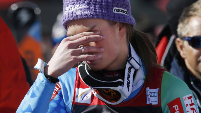 Slovenia's Tina Maze cries after the women's slalom at the  alpine skiing World Cup finals in Lenzerheide, Switzerland, Saturday,  March 16,  2013. (AP Photo/Armando Trovati)