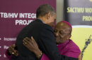 U.S. President Barack Obama, left, hugs Bishop Desmond Tutu during a visit to the Demond Tutu HIV Foundation Youth Center on Sunday, June 30, 2013, in Cape Town, South Africa. (AP Photo/Evan Vucci)