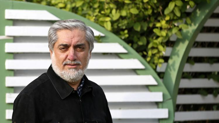 Afghan presidential candidate Abdullah Abdullah arrives for an interview in Kabul