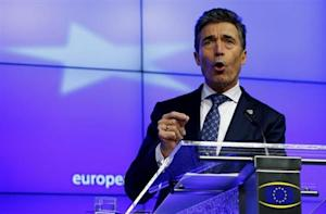 Rasmussen holds a news conference while taking part in a European Union leaders summit in Brussels
