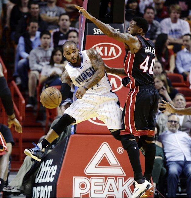 FILE - In this March 6, 2013, file photo, Miami Heat's Udonis Haslem (40) defends against Orlando Magic's Jameer Nelson (14) during the first half of an NBA basketball game in Miami. The Heat won 97-9