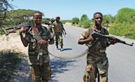 Transitional Federal Government soldiers patrol a stretch of road between Mogadishu and Afgoye in Somalia