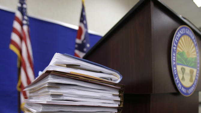 The report detailing the lack of proper supervision and failures in the system that led to a chaotic police chase with 13 officers firing 137 rounds, killing two people rest on a table before a news-conference at the Bureau of Criminal Investigation Tuesday, Feb. 5, 2013, in Richfield, Ohio. Ohio Attorney General Mike DeWine released the first detailed account of the Nov. 29, 2012 shooting. He turned it over to the Cuyahoga County prosecutor, who said the case will be presented to a grand jury to determine if the officers should face charges.(AP Photo/Tony Dejak)