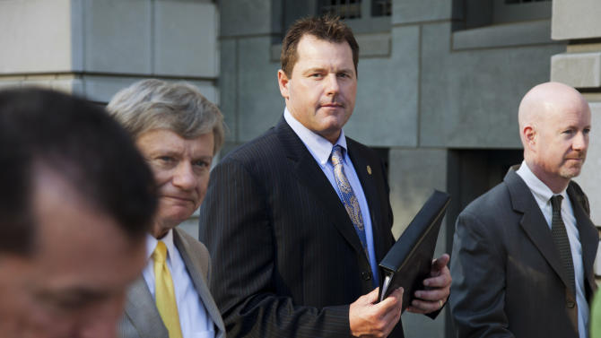 Former Major League Baseball pitcher Roger Clemens leaves the E. Barrett Prettyman United States Court House as his retrial continues on charges that Clemens committed perjury when he told Congress in 2008 that he had never taken steroids or human growth hormone, Thursday, May 3, 2012, in Washington. (AP Photo/Evan Vucci)