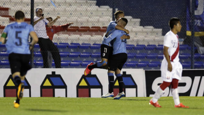 Uruguay's Franco Acosta celebrates with his teammates after scoring a goal against Peru during their South American Under-20 Championship soccer match in Montevideo
