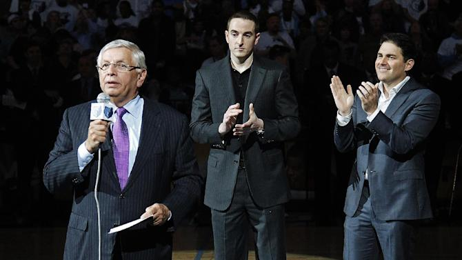 NBA Commissioner David Stern, left, introduces new Memphis Grizzlies chairman Robert J. Pera, center, and new CEO Jason Levien to fans during a ceremony at the Grizzlies' opening night NBA basketball game against the Utaz Jazz in Memphis, Tenn., Monday, Nov. 5, 2012. (AP Photo/Lance Murphey)