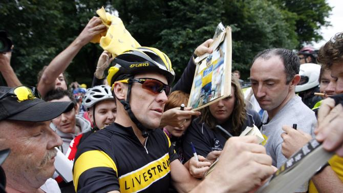 FILE - In this Aug. 25, 2009, file phot, cyclist Lance Armstrong signs autographs as he arrives to cycle around Phoenix Park in Dublin, Ireland.  Over 1,000 riders turned out to cycle with Armstrong after he posted his cycle ride on twitter.  Even after whistleblowers unveiled their scathing report portraying Armstrong as an unrepentant drug cheat, the argument over what to make of his life story rages on.  (AP Photo/Peter Morrison, File)