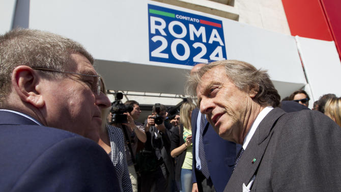 International Olympic Committee, IOC, president Thomas Bach, left, is greeted by  the head of the Rome 2024 Olympic Bid Committee Luca Cordero di Montezemolo, as he arrives to visit the committee's headquarters, in Rome, Friday, May 22, 2015. Bach said Rome has a good chance of securing the 2024 Olympics and bringing the games back to the Italian capital for the first time since 1960. (AP Photo/Andrew Medichini)