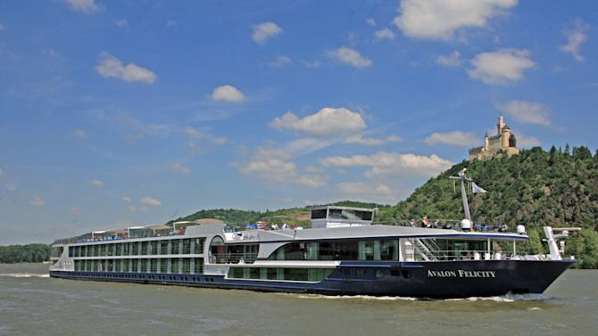 This undated image released by Avalon Waterways shows the river ship Avalon Felicity passing a castle on the Rhine River in Marksburg, Germany. The small scale of river ships, which typically carry no more than a couple hundred passengers, is a large part of their appeal, in contrast to ocean-going mega-ships that carry thousands. On a river ship, you don't need a GPS device to figure out where the lobby or the dining room is. And there's a sense of intimacy, with plenty of cozy moments.  (AP Photo/Avalon Waterways)