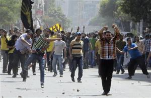 Clashes between supporters of Mohamed Mursi and anti Mursi protesters during march in Shubra street in cairo