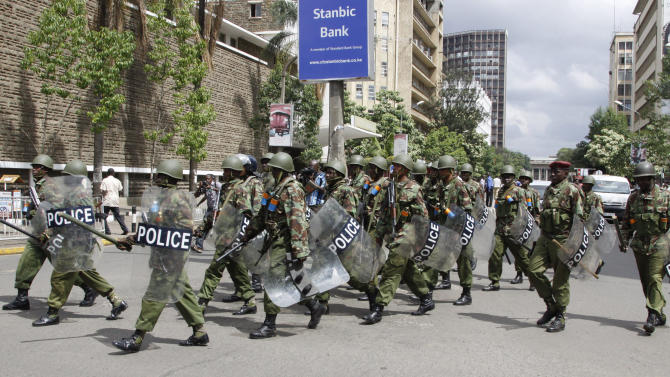 Kenyan police officers patrol near the Supreme Court as the party of Kenya's Prime Minister Raila Odinga file a case with the court over what the claim is massive fraud that took place during the country's March 4 election, in Nairobi, Kenya, Saturday, March 16, 2013. Uhuru Kenyatta won the election with 50.07 percent of the vote. Saturday is the last day Odinga can file a petition to protest the result. Kenya's election has been largely peaceful, unlike the 2007 vote that sparked two months of violence that killed more than 1,000 people. (AP Photo/Khalil Senosi)
