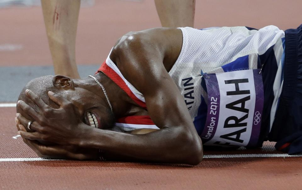 Britain's Mo Farah reacts after winning gold in the men's 10,000-meter final during the athletics in the Olympic Stadium at the 2012 Summer Olympics, London, Saturday, Aug. 4, 2012. (AP Photo/David J. Phillip)