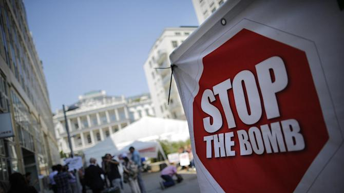 A protester's sign outside the hotel where the Iran nuclear talks are being held in Vienna, Wednesday, July 1, 2015. The head of the U.N. agency tasked to monitor a nuclear deal is traveling to Tehran to meet with Iranian President Hassan Rouhani, the agency said Wednesday. (Carlos Barria/Pool Photo via AP)