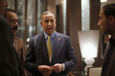 Khaled al-Obeidi speaks to the media in Amman