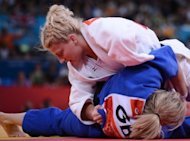 "American Kayla Harrison (top) during her women's -78kg judo final against Britain's Gemma Gibbons on August 2. ""I think that our society puts a lot onto women, how they look and what they wear or how they dress, and I think that being a strong female competitor is the best thing we can do to fight that,"" said Harrison"