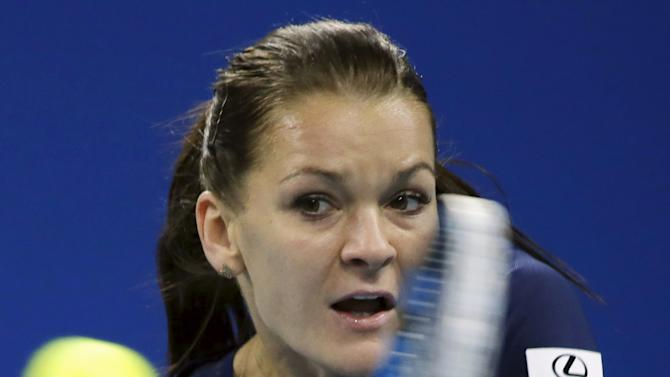 Radwanska hits a return against Muguruza at the China Open tennis tournament in Beijing