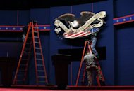 <p>Workers make adjustments to the stage ahead of the first presidential debate at the University of Denver in Colorado. A prime-time debate watched by tens of millions which could help determine the political future of the two rivals.</p>