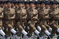 In a photo taken on July 27, 2013 North Korean soldiers march through Kim Il-Sung square in Pyongyang, during a military parade marking the 60th anniversary of the Korean war armistice