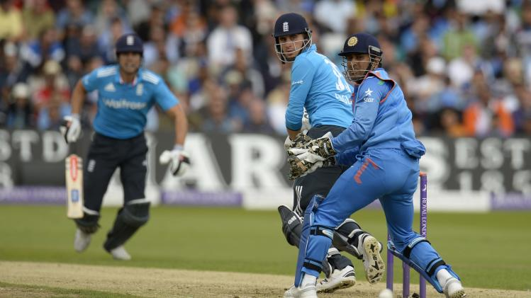 England's Hales hits the ball past India's Dhoni during the third one-day international cricket match at Trent Bridge cricket ground, Nottingham
