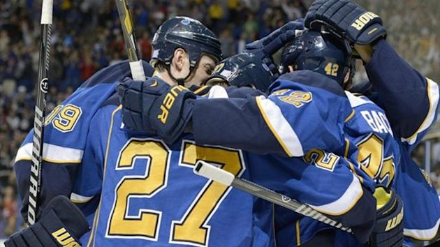 St. Louis Blues center David Backes (right) is congratulated by team-mates after scoring (Reuters)