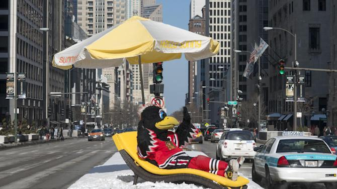 IMAGE DISTRIBUTED FOR GREATER FORT LAUDERDALE - Chicago Blackhawks mascot Tommy Hawk lounges in the middle of Michigan Avenue as the Greater Fort Lauderdale Convention & Visitors Bureau says goodbye chilly, Hello Sunny today on Michigan Avenue in Chicago with their Hello Sunny campaign, Wednesday February 6, 2013. The CVB's promotion encourages Chicagoans and the nation to enjoy the warm Greater Fort Lauderdale sunshine. Visit www.sunny.org/defrost for a chance to win a Fort Lauderdale beach getaway. (Peter Barreras/Invision for Greater Fort Lauderdale/AP Images)