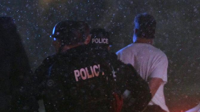 A suspect is taken into custody outside a Planned Parenthood center in Colorado Springs, Colorado