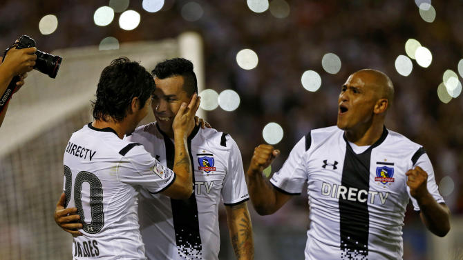 Paredes, Valdes and Suazo of Chile's Colo Colo celebrate a goal against Mexico's Atlas during their Copa Libertadores soccer match in Santiago