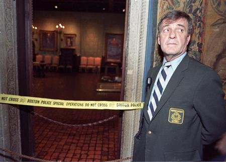 Security guard Paul Daley stands guard at the door of the Dutch Room of the Isabella Stewart Gardner Museum in Boston