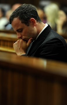 Oscar Pistorius listens to state prosecutor summarize his evidence Thursday. (AP)