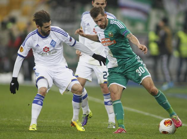Dynamo Kiev's Veloso fights for the ball with Rapid Vienna's Burgstaller during their Europa League soccer match in Kiev