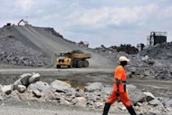 A worker walks past one of the three crushing circuits at the diamond mining company Koidu Holdings plant in Koidu, the capital of the diamond-rich Kono district, in eastern Sierra Leone, some 250 km east from Freetown in April
